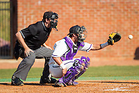 High Point Panthers catcher Josh Spano (21) catches a pitch as home plate umpire Drew Mahar looks on during the game against the Bowling Green Falcons at Willard Stadium on March 9, 2014 in High Point, North Carolina.  The Falcons defeated the Panthers 7-4.  (Brian Westerholt/Four Seam Images)