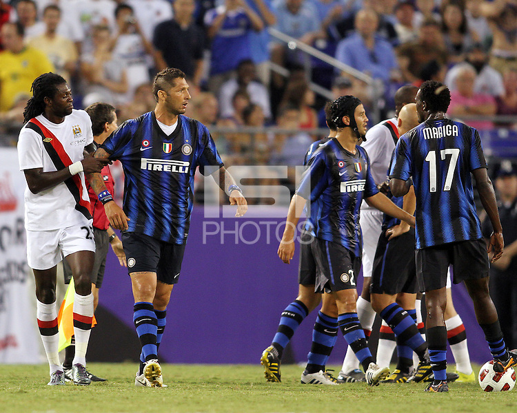 Marco Materazzi #23 of Inter Milan is held back by Emmanuel Adebayor #25 of Manchester City during an international friendly match on July 31 2010 at M&T Bank Stadium in Baltimore, Maryland. Milan won 3-0.