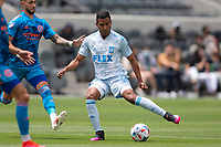 LOS ANGELES, CA - MAY 29: Eddie Segura #4 of LAFC passes off a ball during a game between New York City FC and Los Angeles FC at Banc of California Stadium on May 29, 2021 in Los Angeles, California.