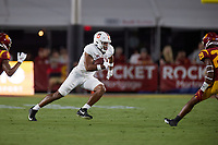 LOS ANGELES, CA - SEPTEMBER 11: Elijah Higgins #6 of the Stanford Cardinal runs after a pass reception during a game between University of Southern California and Stanford Football at Los Angeles Memorial Coliseum on September 11, 2021 in Los Angeles, California.