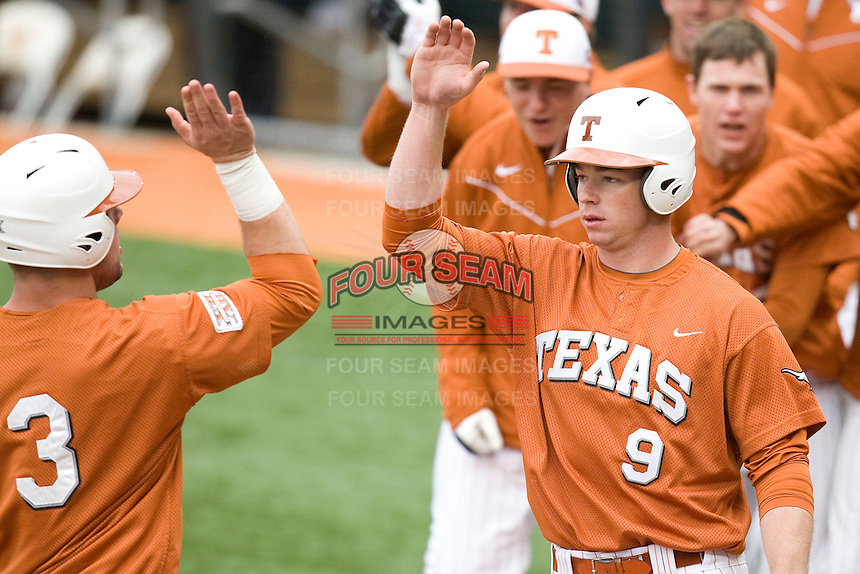 Tant Shepard of the Texas Lonhorns welcomes teammate Cameron Rupp (#3) home against the Stanford Cardinal at  UFCU Disch-Falk Field in Austin, Texas on Friday February 26th, 2100.  (Photo by Andrew Woolley / Four Seam Images)