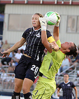 Abby Wambach #20 of the Washington Freedom goes for a high ball against Jillian Loyden #1 of the Chicago Red Stars during a WPS match at Maryland Soccerplex on August 19 2010, in Boyds, Maryland. Freedom won 2-0.