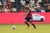 KANSAS CITY, KS - JULY 15: Cristian Roldan #10 of the United States looks for an open man during a game between Martinique and USMNT at Children's Mercy Park on July 15, 2021 in Kansas City, Kansas.