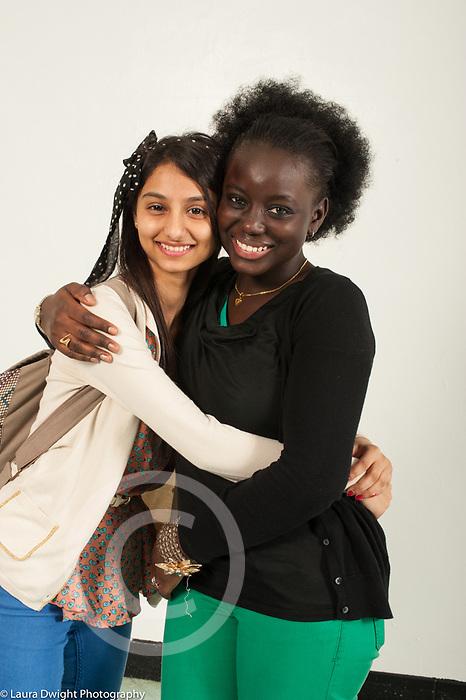 Education High School Senior informal portraits two friends hugging