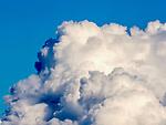 Cumulous cloud study with faces.