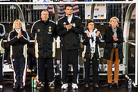 Germany (GER) head coach Silvia Neid ® with members of her coaching staff. The United States (USA) and Germany (GER) played to a 2-2 tie during an international friendly at Rentschler Field in East Hartford, CT, on October 23, 2012.