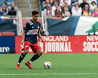 FOXBOROUGH, MA - JULY 25: Brando Bye #15 of New England Revolution dribbles during a game between CF Montreal and New England Revolution at Gillette Stadium on July 25, 2021 in Foxborough, Massachusetts.