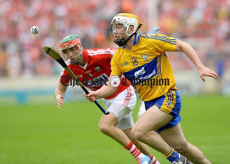 Conor Mc Grath of Clare in action against Stephen Mc Donnell of Cork during the Senior hurling championship semi-final at Thurles. Photograph by John Kelly.l