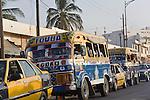 Colorfully painted buses roam the streets of Dakar, Senegal.