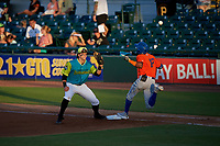 Bradenton Barbanegras first baseman Mason Martin (47) waits for a throw as Hansel Moreno (12) runs through the bag during a Florida State League game against the St. Lucie Mets on July 27, 2019 at LECOM Park in Bradenton, Florida.  Bradenton defeated St. Lucie 3-2.  (Mike Janes/Four Seam Images)
