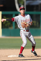 Lonnie Kauppila of the Stanford Cardinal makes a throw against the USC Trojans at Dedeaux Field in Los Angeles,California on April 8, 2011. Photo by Larry Goren/Four Seam Images