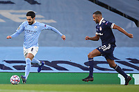 3rd November 2020; City of Manchester Stadium, Manchester, England. UEFA Champions League group stages, Manchester City versus Olympiacos;  Ilkay Gundogan  Manchester breaks from Youssef El Arabi (OL)