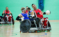 15 AUG 2011 - LEEDS, GBR - Canada's Mike Whitehead (right) prepares to pass during the wheelchair rugby exhibition match against Great Britain (PHOTO (C) NIGEL FARROW)