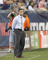New England Revolution coach Jay Heaps. In a Major League Soccer (MLS) match, Sporting Kansas City defeated the New England Revolution, 1-0, at Gillette Stadium on August 4, 2012.