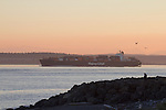 Container Ship, Kobe Express, Hapag Lloyd line, outbound for the Pacific Ocean, Point Wilson lighthouse, Puget Sound, Admiralty Inlet, Washington State, Pacific Northwest, USA,