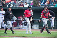 James Marinan (58), Luis Alecis (56), and Pabel Manzanero (47) of the Billings Mustangs walk towards the dugout before a Pioneer League game against the Idaho Falls Chukars at Melaleuca Field on August 22, 2018 in Idaho Falls, Idaho. The Idaho Falls Chukars defeated the Billings Mustangs by a score of 5-3. (Zachary Lucy/Four Seam Images)