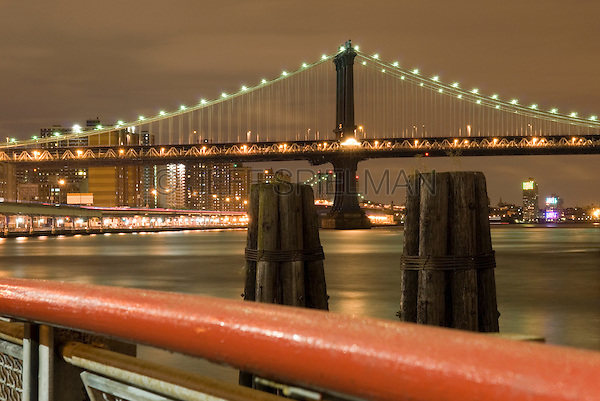 Brooklyn Bridge and East River Illuminated at Night