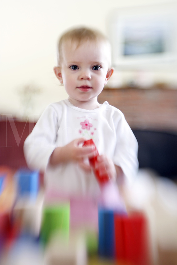 Girl playing with colorful blocks<br />
