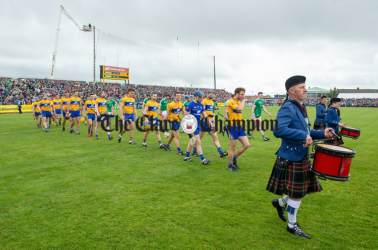 Patrick O Connor of Clare leads out his team behind the Tulla Pipe Band before  before their Munster championship game in Ennis. Photograph by John Kelly.