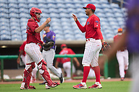 Clearwater Threshers catcher Abrahan Gutierrez (10) and pitcher Carlos A Francisco (35) celebrate closing out a game against the Fort Myers Mighty Mussels on July 29, 2021 at BayCare Ballpark in Clearwater, Florida.  (Mike Janes/Four Seam Images)