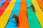 Drying colourful fabric by Sarah Wouters