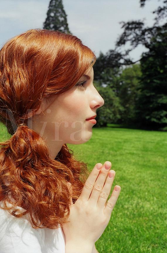 Young girl praying..MR