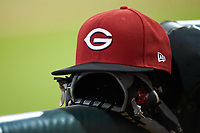 A Greeneville Reds cap sits on top of a baseball glove during the game against the Pulaski Yankees at Calfee Park on June 23, 2018 in Pulaski, Virginia. The Reds defeated the Yankees 6-5.  (Brian Westerholt/Four Seam Images)