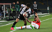 BOGOTA -COLOMBIA, 19-04-2017.   Victor Ferraz (L)<br /> player of   Santos of Brazil fights the ball agaisnt of Yeison Gordillo (R) player of  Independiente Santa Fe of Colombia during match for the date 3   for the Conmebol Libertadores Bridgestone Cup 2017 played at Nemesio Camacho El Campin stadium . Photo:VizzorImage / Felipe Caicedo  / Staff