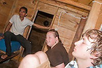 Passengers in the cabin of a boat crossing the Wetar Strait from Dili to Atauro Island, Timor-Leste (East Timor)