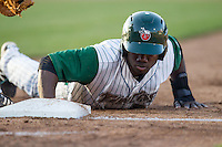 Fort Wayne TinCaps shortstop Ruddy Giron (12) dives back to first base against the West Michigan Whitecaps on May 23, 2016 at Parkview Field in Fort Wayne, Indiana. The TinCaps defeated the Whitecaps 3-0. (Andrew Woolley/Four Seam Images)