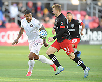 WASHINGTON, DC - MARCH 07: Julian Gressel #31 of D.C. United battles the ball with Roman Torres #29 of Inter Miami CF during a game between Inter Miami CF and D.C. United at Audi Field on March 07, 2020 in Washington, DC.