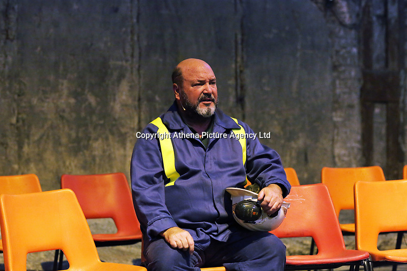 """Pictured: Actor Sion Tudor Owen<br /> Re: Press rehearsal of """"We'Re Still Here"""", a play created by Rachel Trezise, Common Wealth and the National Theatre Wales about steelworkers, which will be performed in Byass Works, a disused industrial unit, in Port Talbot, south Wales, UK."""