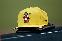 A Charlotte Traffic Cones cap sits on the dugout railing during the game against the Norfolk Tides at Truist Field on August 20, 2021 in Charlotte, North Carolina. (Brian Westerholt/Four Seam Images)