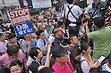Demonstrators protest Japanese Prime Minister Abe's security policies in front of Shibuya Station