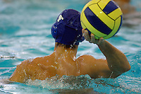 A female water polo player goes after a loose ball during a game
