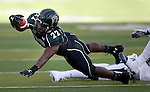 Hawaii's Diocemy Saint Juste (22) dives for extra yards against Nevada during the first half of an NCAA college football game in Reno, Nev., on Saturday, Sept. 21, 2013. (AP Photo/Cathleen Allison)
