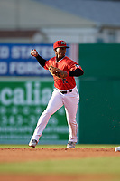 Batavia Muckdogs second baseman Samuel Castro (15) throws to first base during a NY-Penn League game against the Auburn Doubledays on June 14, 2019 at Dwyer Stadium in Batavia, New York.  Batavia defeated 2-0.  (Mike Janes/Four Seam Images)