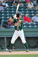 Third baseman Brian Schales (43) of the Greensboro Grasshoppers bats in a game against the Greenville Drive on Wednesday, August 26, 2015, at Fluor Field at the West End in Greenville, South Carolina. Greenville won, 7-0.  (Tom Priddy/Four Seam Images)