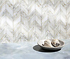 Vero, a hand-cut stone mosaic, show in polished Calacatta Gold, is part of the Semplice® collection for New Ravenna.