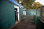 Nelson 3 Daisy Hill 6, 12/10/2019. Victoria Park, North West Counties League, First Division North. A club official sweeping out the referee's room before Nelson hosted Daisy Hill at Victoria Park. Founded in 1881, the home club were members of the Football League from 1921-31 and has played at their current ground, known as Little Wembley, since 1971. The visitors won this fixture 6-3, watched by an attendance of 78. Photo by Colin McPherson.