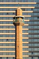 Israel,Tel Aviv,Spring Tel Aviv promenade. Arab mosque and minaret on the background of high-rise hotel.