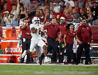 LOS ANGELES, CA - SEPTEMBER 11: Nathaniel Peat #8 of the Stanford Cardinal runs for a touchdown during a game between University of Southern California and Stanford Football at Los Angeles Memorial Coliseum on September 11, 2021 in Los Angeles, California.