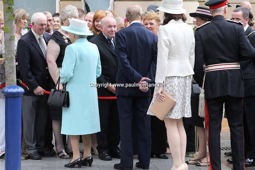 Britain's Queen Elizabeth II and the Duke of Edinburgh greet local people from Coleraine, County Antrim, as they finish their three day tour of Northern Ireland, Wednesday June 25, 2014. Photo/Paul McErlane