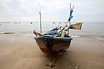 A fishing boat sits on the beach in Mui Ne, Vietnam. Nov. 20, 2011.
