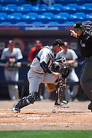 Brevard County Manatees catcher Fidel Pena (18) looks for the baseball as umpire Mike Savakinas gets out of the way during a game against the St. Lucie Mets on April 17, 2016 at Tradition Field in Port St. Lucie, Florida.  Brevard County defeated St. Lucie 13-0.  (Mike Janes/Four Seam Images)