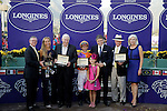 ARCADIA, CA - NOV 04: The connections for Beholder poses for a photograph in the winner's circle after winning the Breeders' Cup Longines Distaff at Santa Anita Park on November 4, 2016 in Arcadia, California. (Photo by Bob Mayberger/Eclipse Sportswire/Breeders Cup)