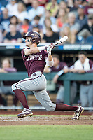 Mississippi State Bulldogs outfielder Jake Mangum (15) follows through on his swing during Game 10 of the NCAA College World Series against the Louisville Cardinals on June 20, 2019 at TD Ameritrade Park in Omaha, Nebraska. Louisville defeated Mississippi State 4-3. (Andrew Woolley/Four Seam Images)