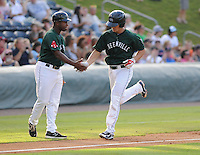 Catcher Carson Blair (18) of the Greenville Drive is congratulated by manager Billy McMillon after hitting a home run against the Rome Braves in a game on July 17, 2011, at Fluor Field at the West End in Greenville, South Carolina. (Tom Priddy/Four Seam Images)