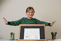 BNPS.co.uk (01202) 558833<br /> Pic: Zachary Culpin/BNPS <br /> <br /> Valya Constable with his drawing that's set to be exhibited.<br /> <br /> The Royal Academy is to exhibit the first artwork by a Constable in 200 years - in the form of a drawing by a seven-year-old descendant of The Hay Wain painter.<br /> <br /> Valya Constable, the great-great-great-great-grandson of John Constable, has had his sketch of his nan's feet and legs accepted by the prestigious art institution.<br /> <br /> It will form part of a young artists' exhibition and will go on display next week.