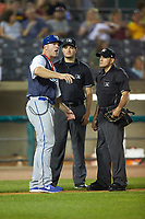 Lexington Legends manager Scott Thorman (35) argues a call with home plate umpire Kelvis Velez (right) and base umpire Ben Fernandez during the game against the West Virginia Power at Appalachian Power Park on June 7, 2018 in Charleston, West Virginia. The Power defeated the Legends 5-1. (Brian Westerholt/Four Seam Images)